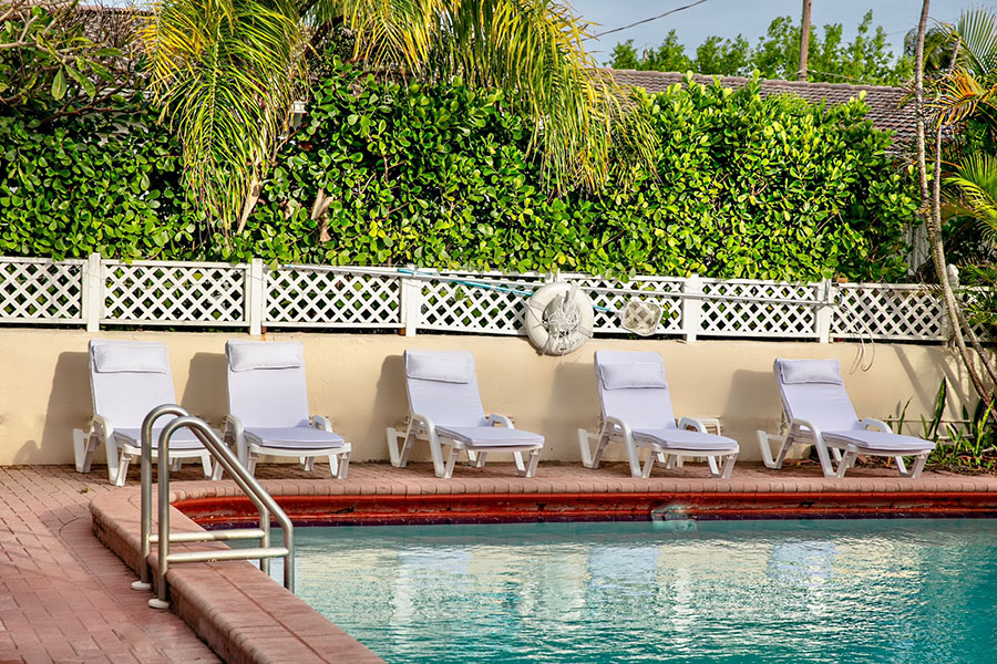 outdoor pool and lounge chairs