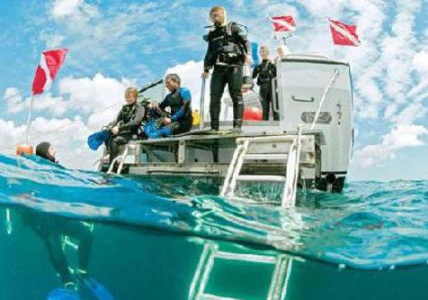 scuba diving off a boat